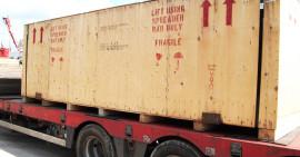 bekisting, vastleggen van machines in kisten, helpen in transport en verscheping